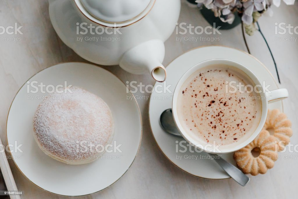 Donuts on plate on woode board with hot coffee for breakfast stock photo
