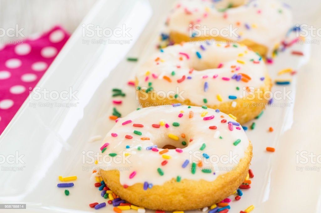 Donuts On White Tray With Sprinkles stock photo