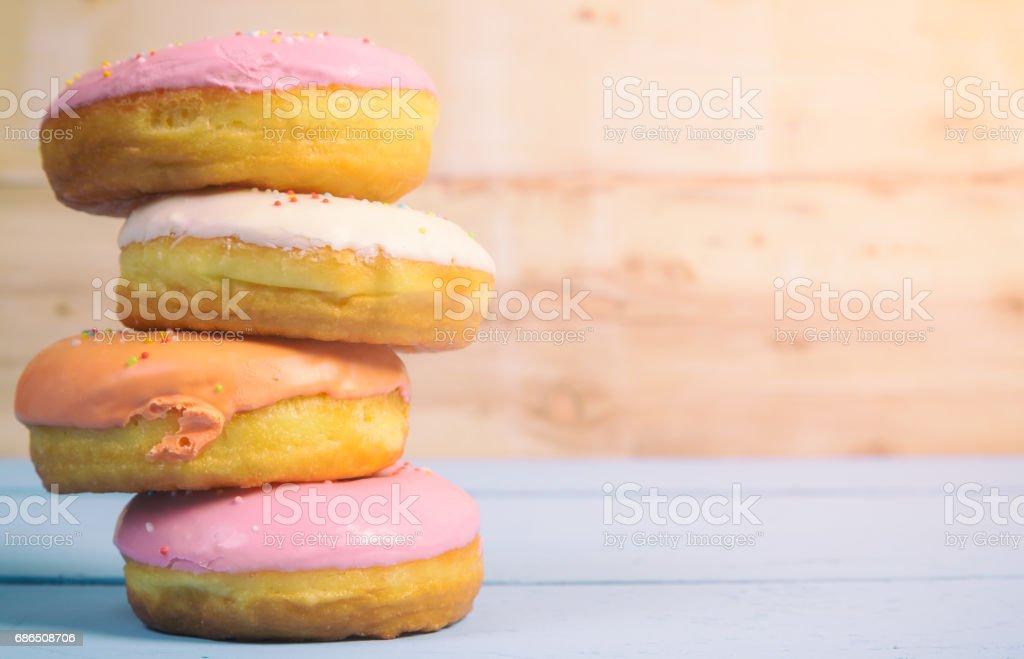 donuts on wood background royaltyfri bildbanksbilder