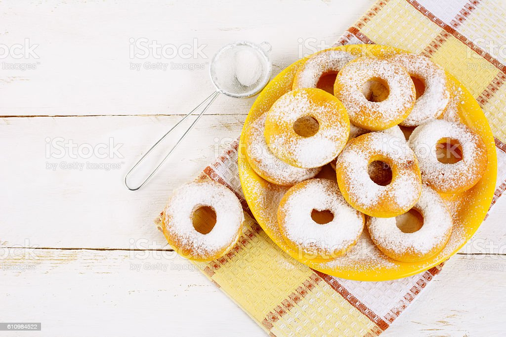 Donuts served on yellow plate top view copy space stock photo