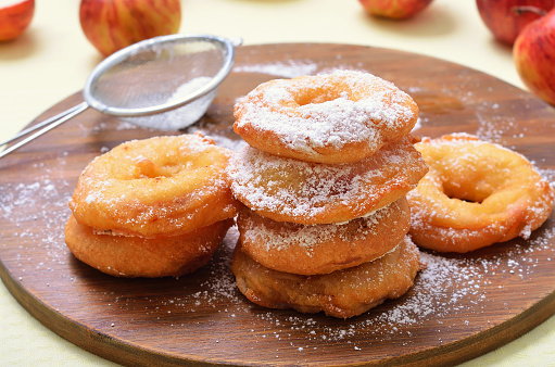 Donuts with apples and powdered sugar