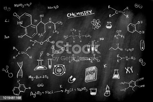 istock doodle of chemistry formula subject on black chalk board background for education science concept 1019481168