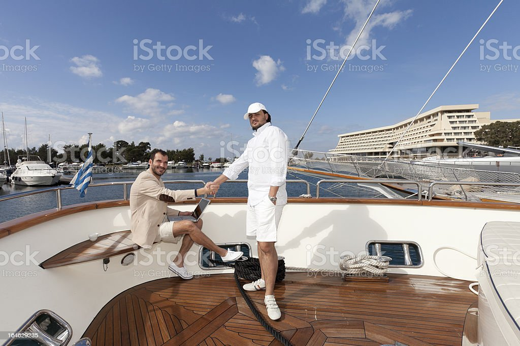 Dooing business on yacht royalty-free stock photo