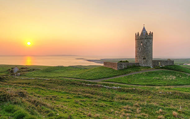 doonagore castle at sunset - county clare stock pictures, royalty-free photos & images