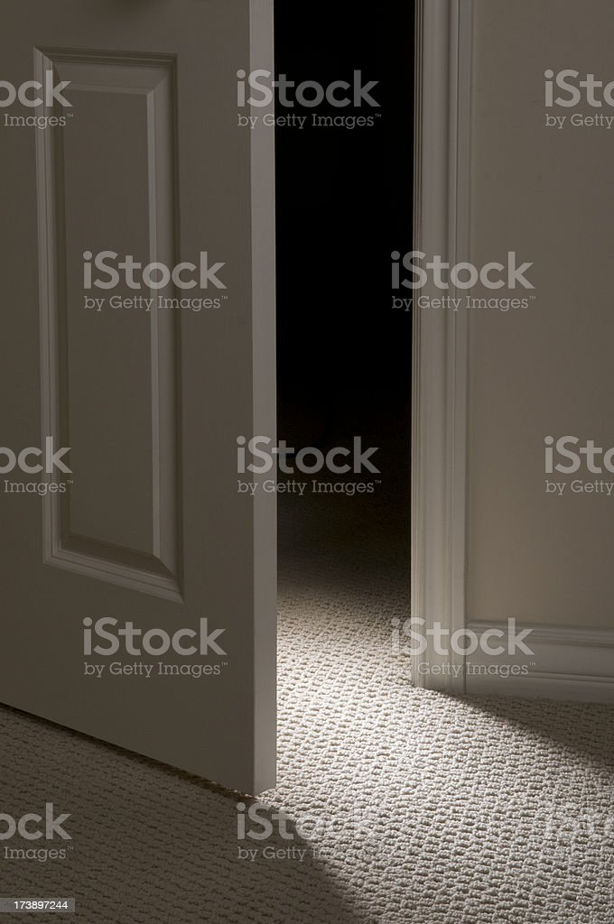 Door Ajar With Dramatic Light royalty-free stock photo