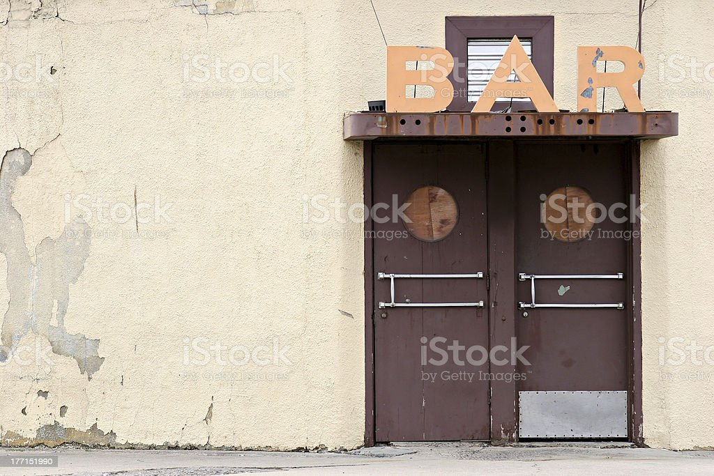 A door and a bar sign above it stock photo