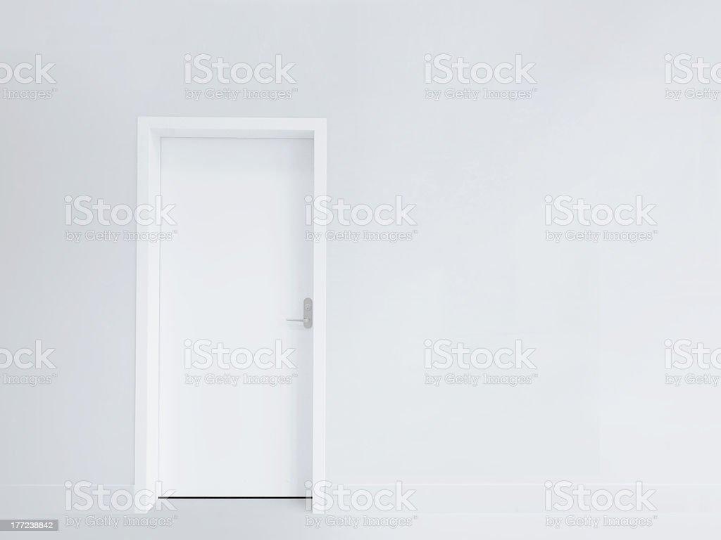 Door and blank wall stock photo