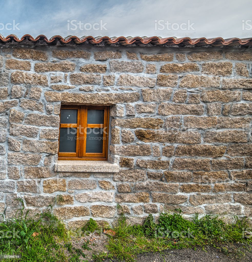 door and window in a rustic wall stock photo
