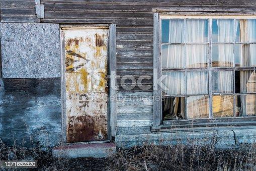 door and window of an old building, SK, Canada.