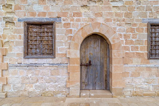 Door and windows of one of the rooms surrounding the main yard of the citadel of Alexandria, Egypt