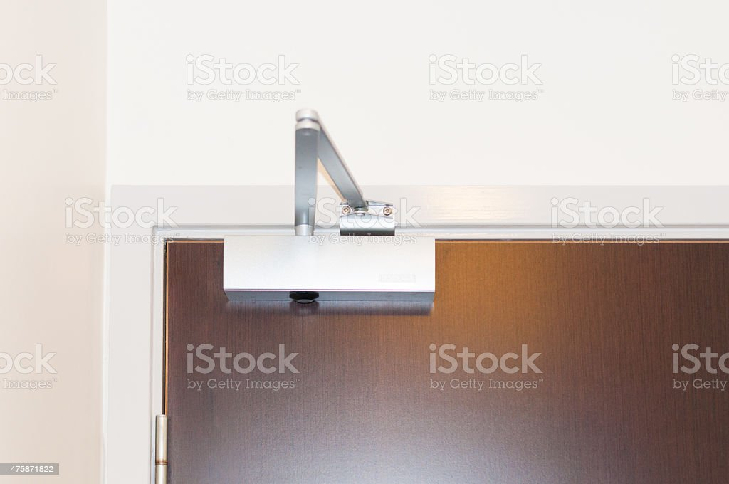 Door closer or shock absorber installation stock photo