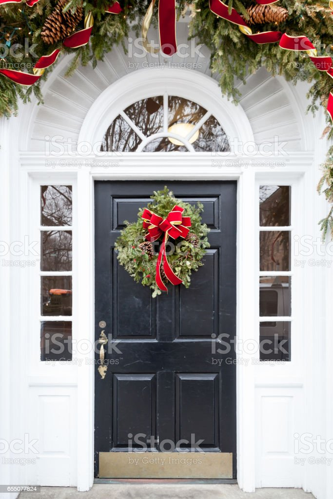 Door Decorated for Christmas stock photo & Royalty Free Kicking Door Pictures Images and Stock Photos - iStock
