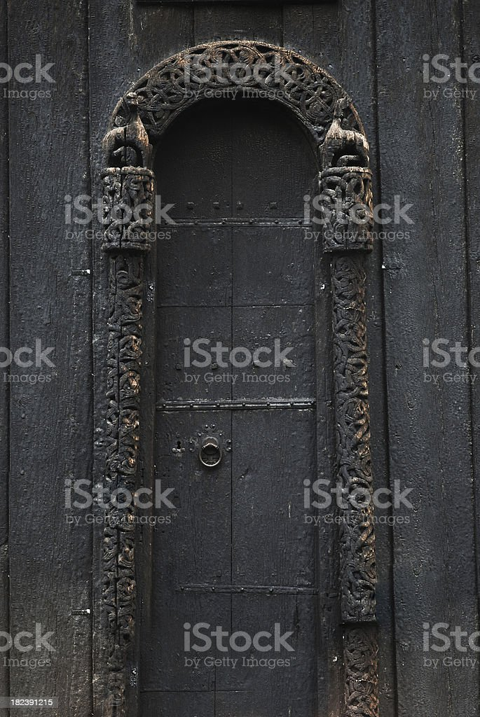 Door - Detail from old medieval church royalty-free stock photo