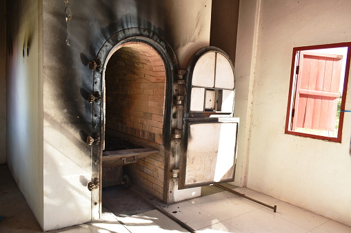 door for push wooden coffin to burning in cremation furnace building on temple