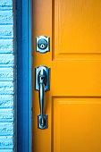 istock Door handle with a lock on wooden door 1049576378