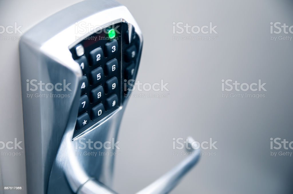Door handle with modern electronic combination lock stock photo