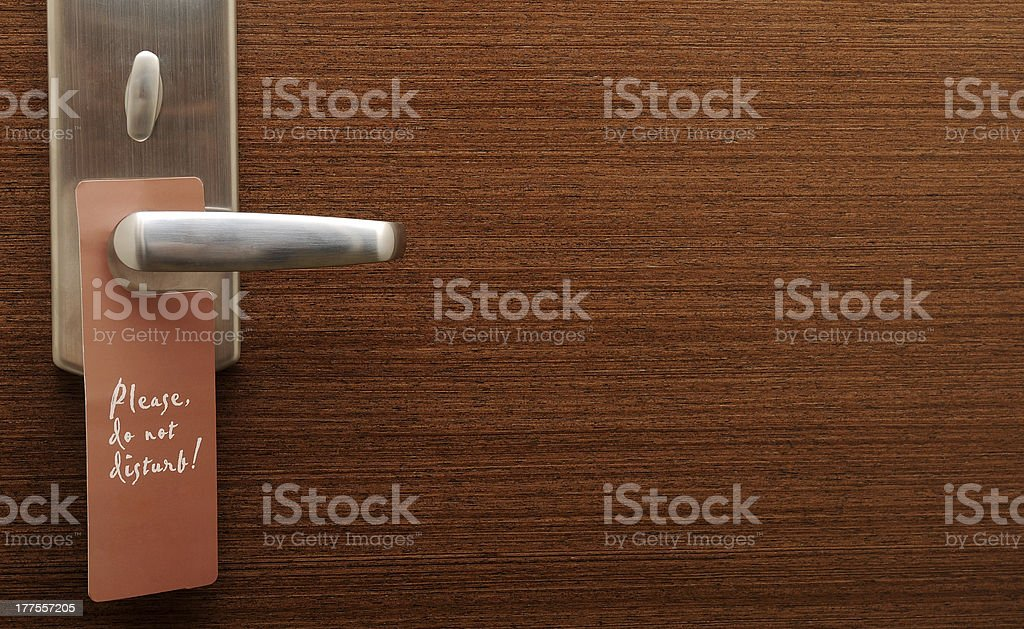 Door handle with sing stock photo