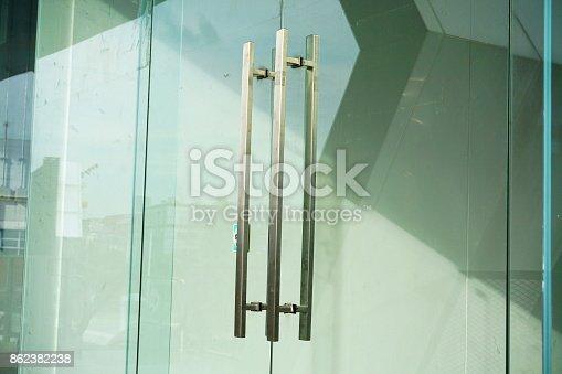 istock Door Handles on a Glass Office Building 862382238