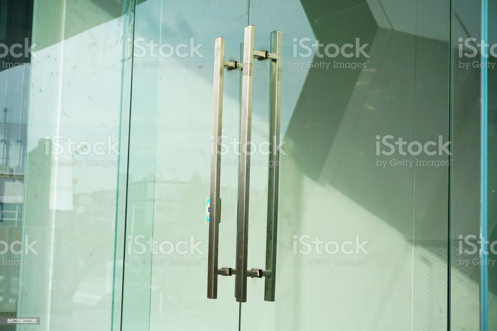 Door Handles on a Glass Office Building stock photo
