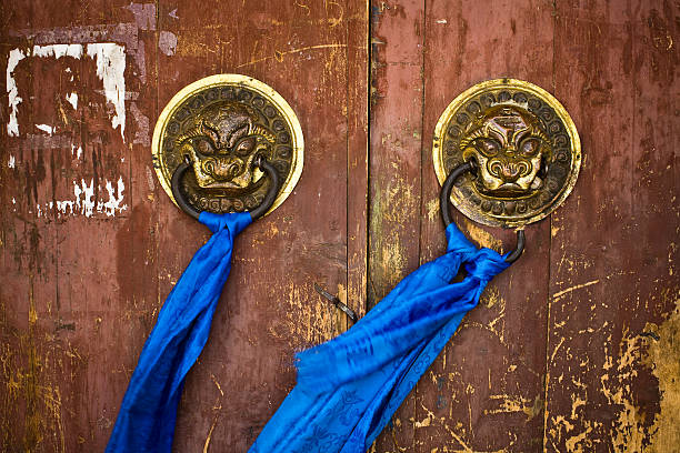 Door handles on ancient temple Ornate door handles and prayer scarves on ancient Eredene Zuu monastery Karakorum, Mongolia. mongolian culture stock pictures, royalty-free photos & images