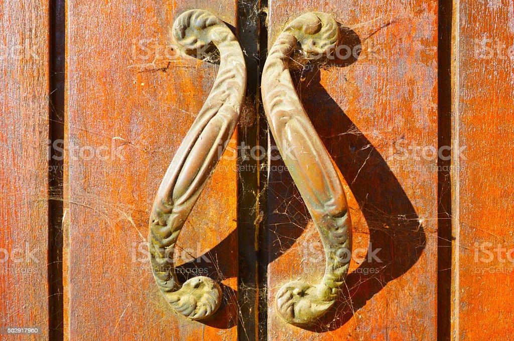 Door handles with spiderwebs stock photo