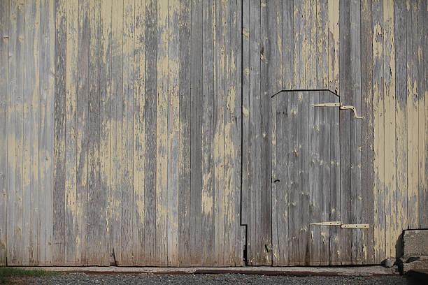 Door in a barn wall stock photo
