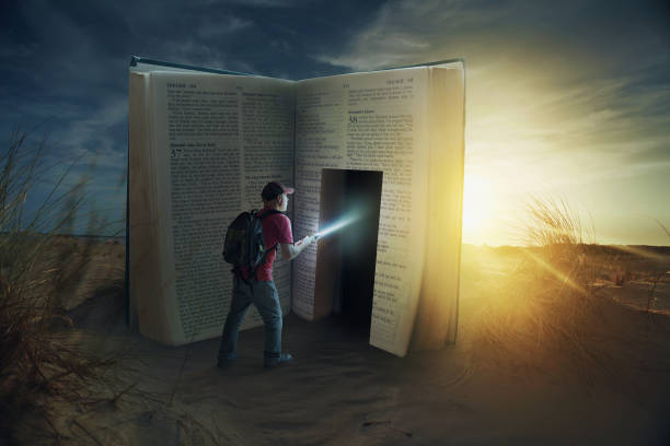 Door in Bible A man discovers a door inside a Bible. finding stock pictures, royalty-free photos & images