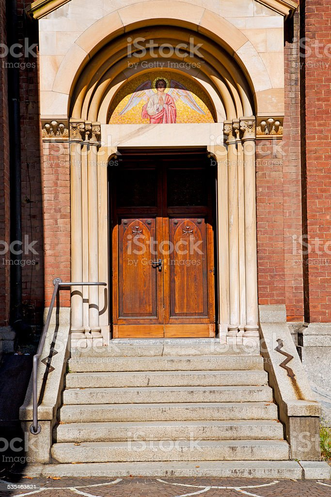 door   in italy  lombardy   column  the angel stock photo