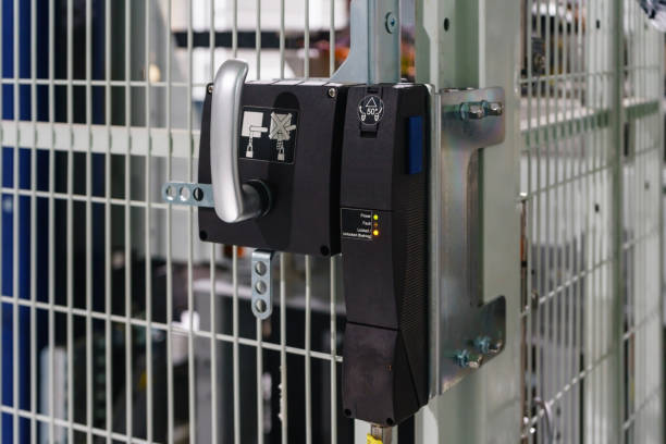 Door Interlock Switches for the protection of safety doors before entry machine stock photo