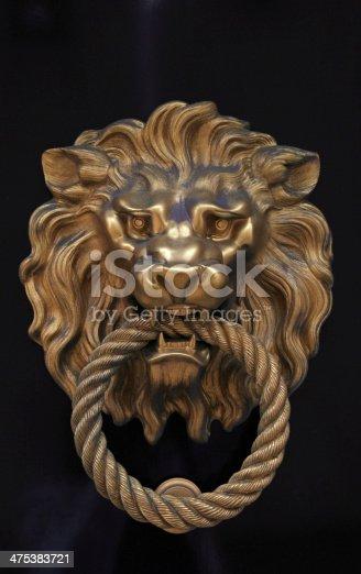 istock Door knob in the shape of brass lion 475383721