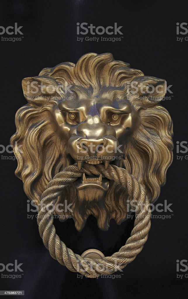 Door knob in the shape of brass lion stock photo