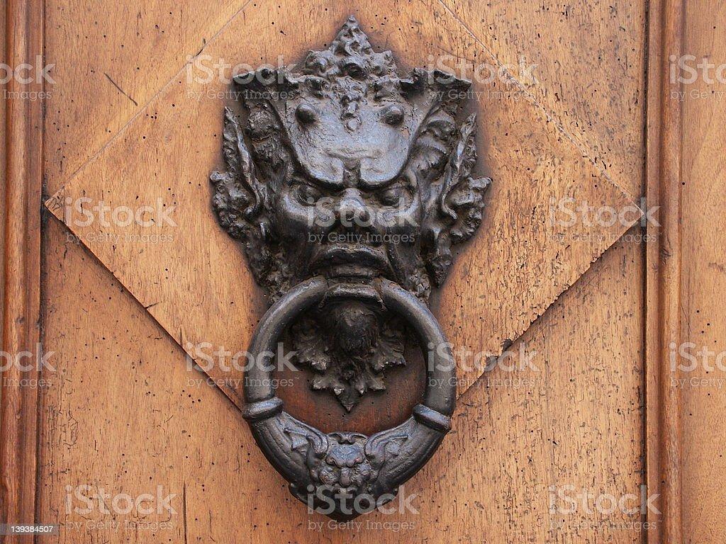Door knocker in Florence, Italy royalty-free stock photo
