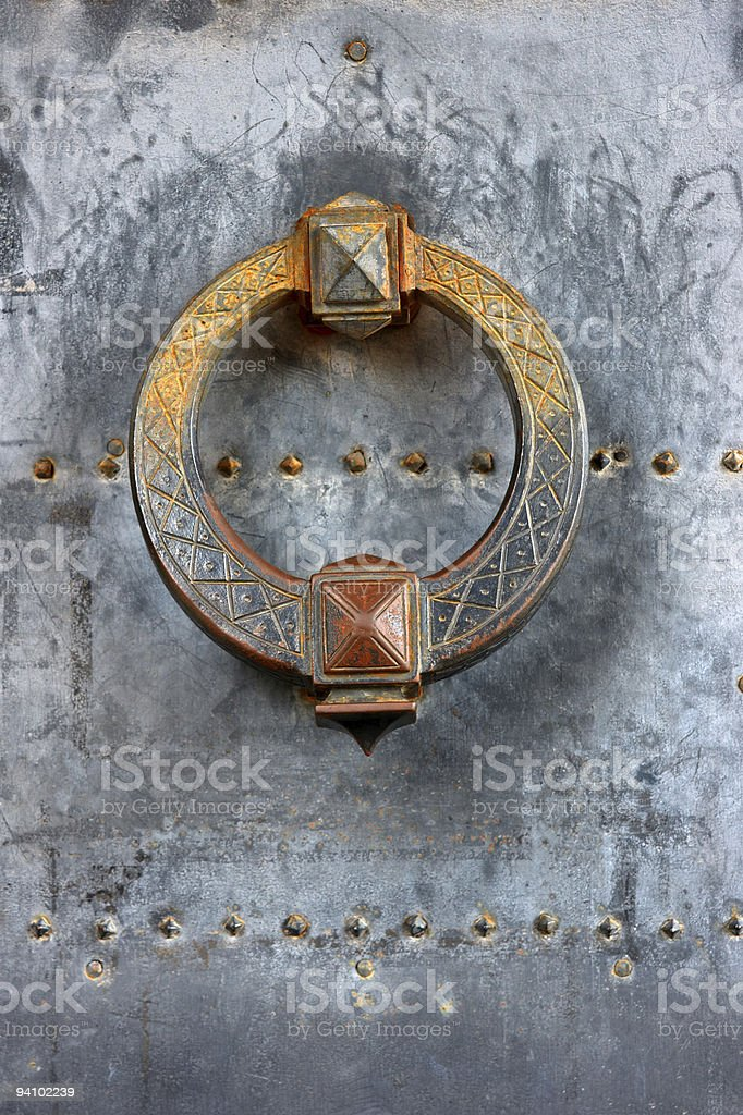 Door knocker of ancient castle gate royalty-free stock photo