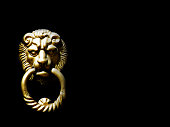 Lion's head door knocker on the black background isolated