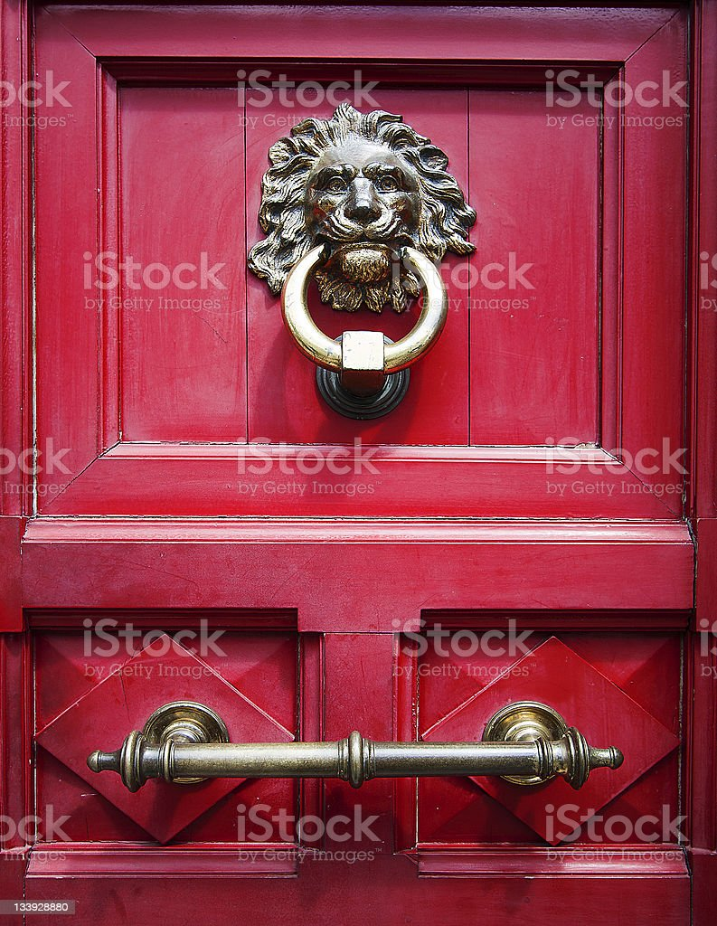 door knocker with a lion head royalty-free stock photo