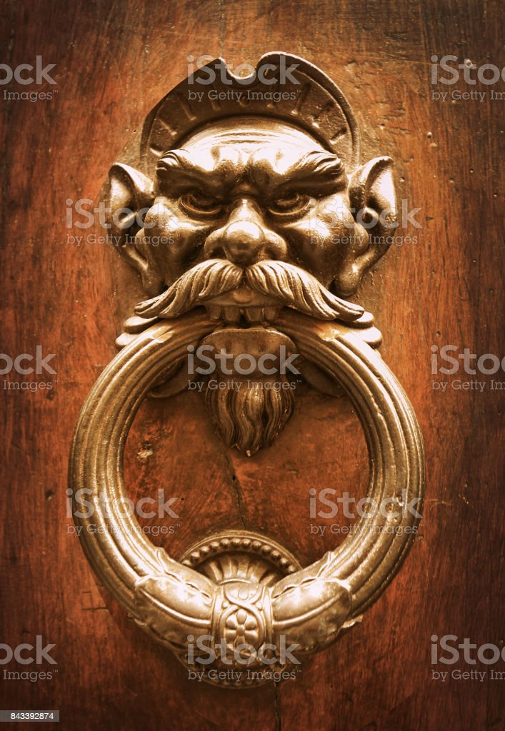 Door knocker with evil man head stock photo
