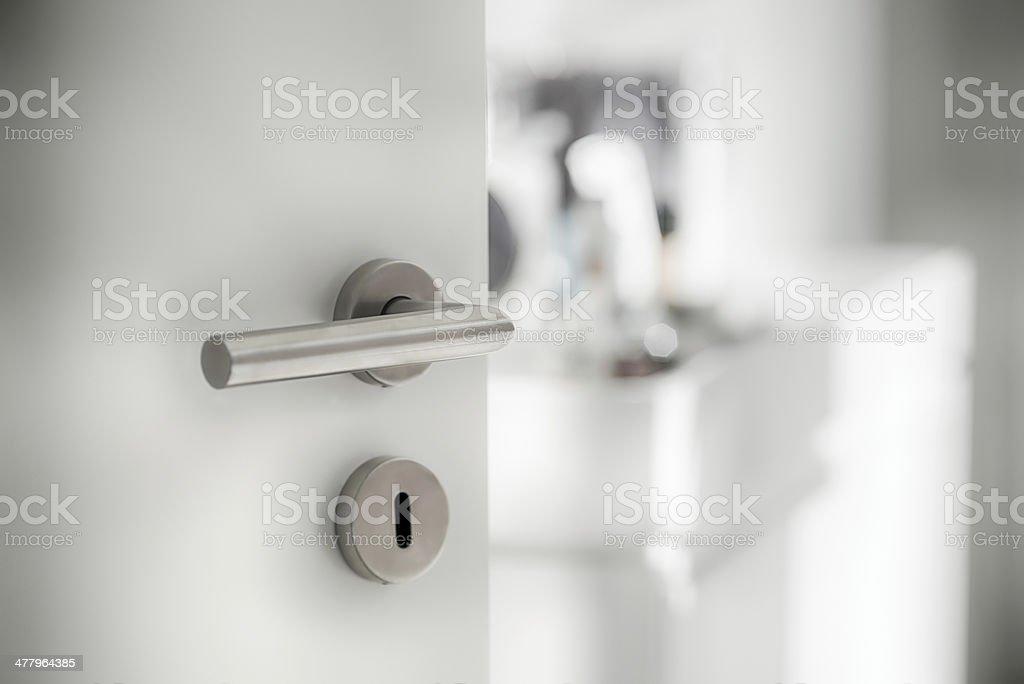 Door latch at the bathroom stock photo