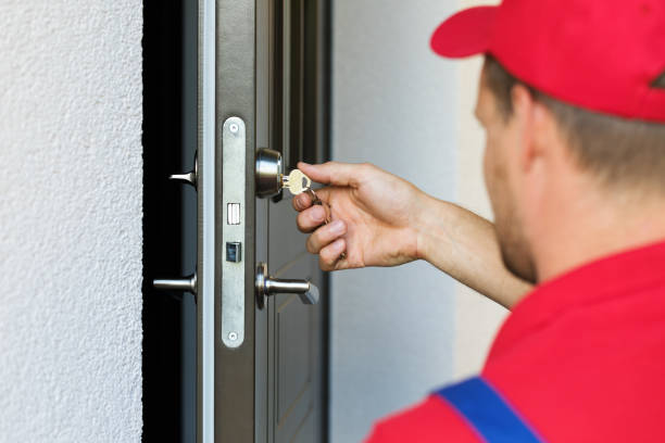 door lock service - locksmith working in red uniform door lock service - locksmith working in red uniform locksmith stock pictures, royalty-free photos & images