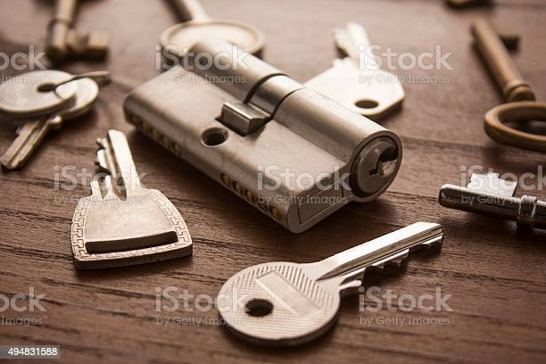 door lock with keys on wooden surface door lock with keys 2015 Stock Photo