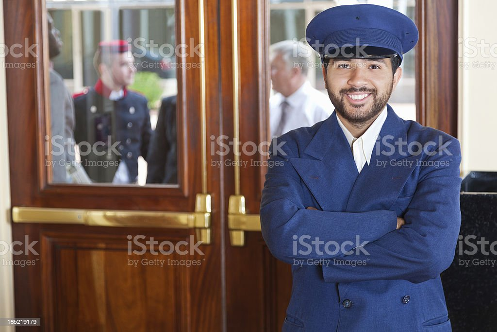 Door man portrait at a 5-Star hotel entrance royalty-free stock photo