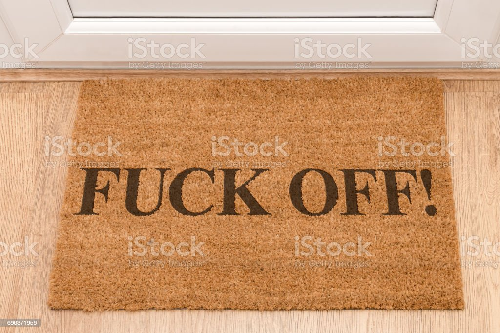 door mat at front door with expletive fck off royaltyfree stock photo