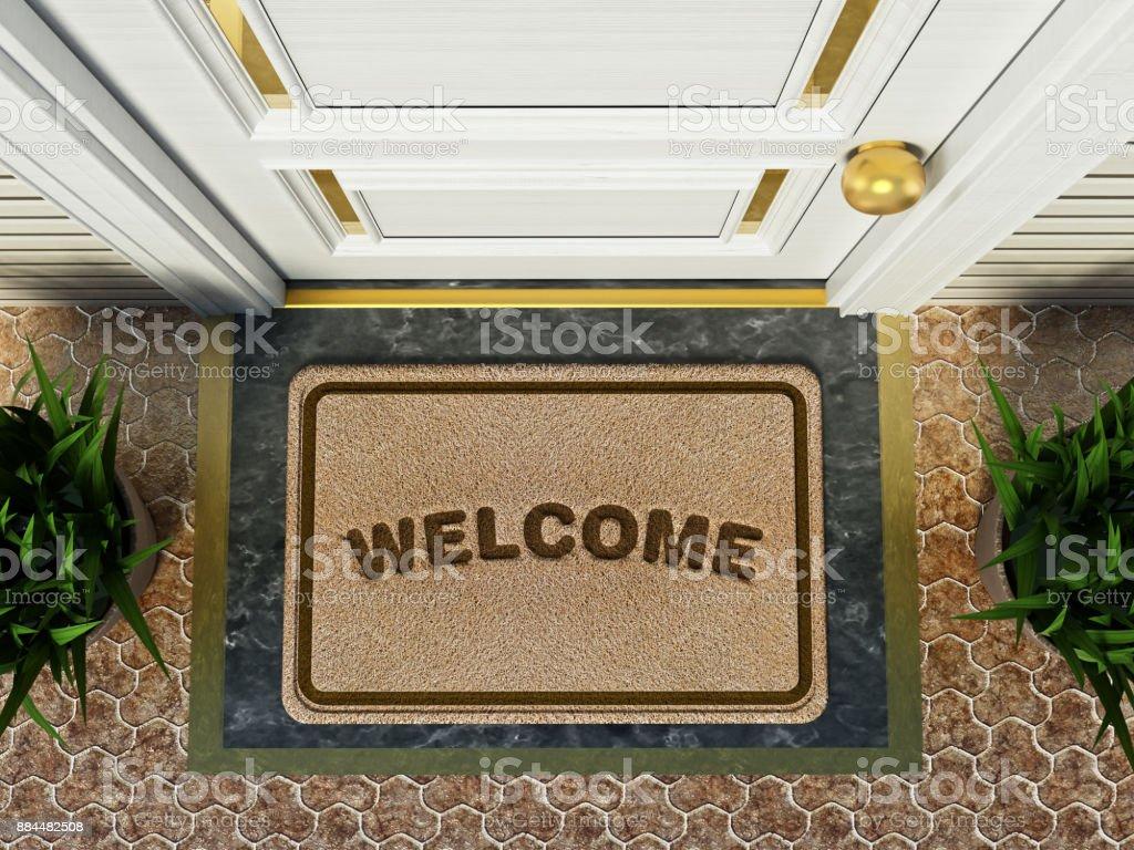 Fußmatte willkommen Wort steht vor der Haustür – Foto