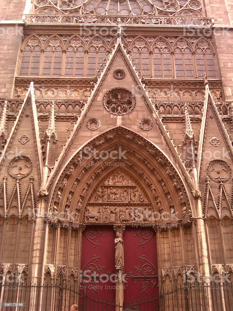 Door of a cathedral in Paris stock photo