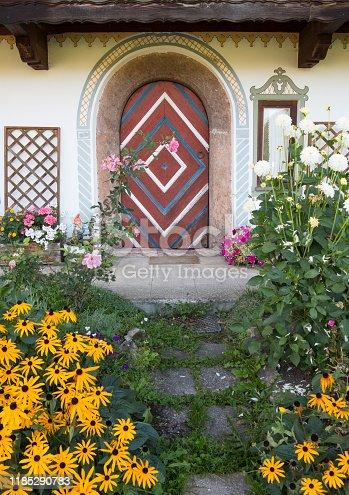 Door of an old house with frontyard garden
