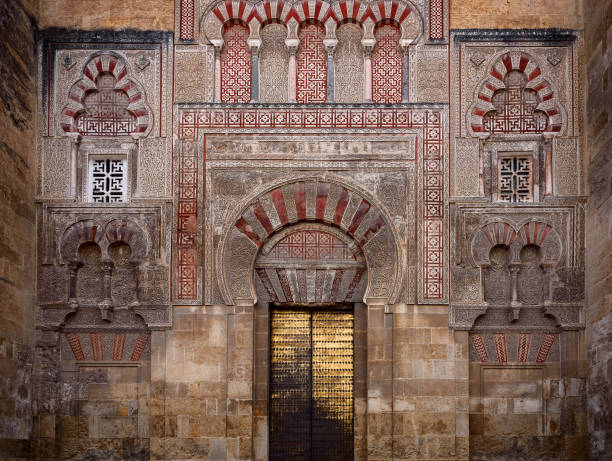 door of mezquita in cordoba view of an old door of the external wall of the mezquita in cordoba. andalusia. spain cordoba spain stock pictures, royalty-free photos & images