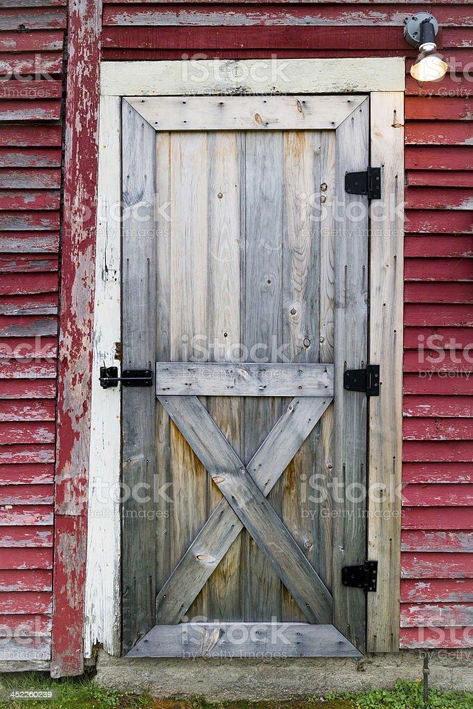 Door on Red Barn stock photo