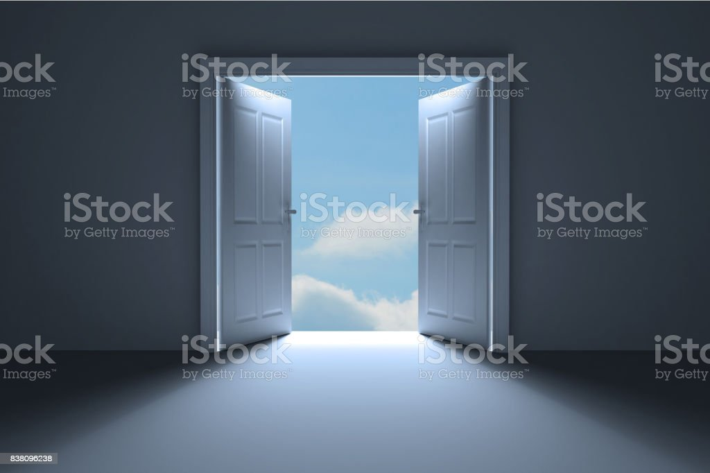 Door opening in room to show sky stock photo