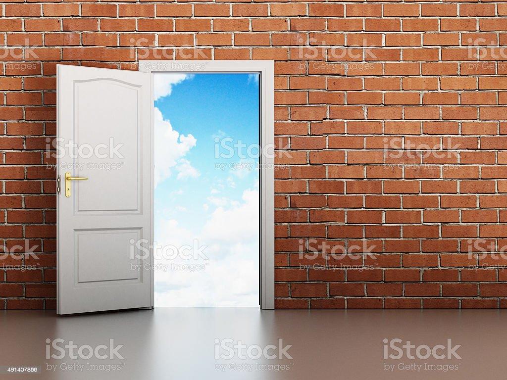 Door opening to the blue sky stock photo