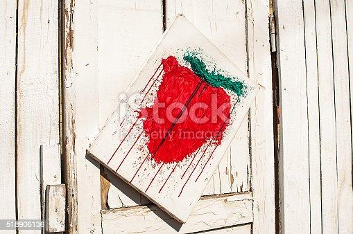 914465180 istock photo door painted strawberries 518906136