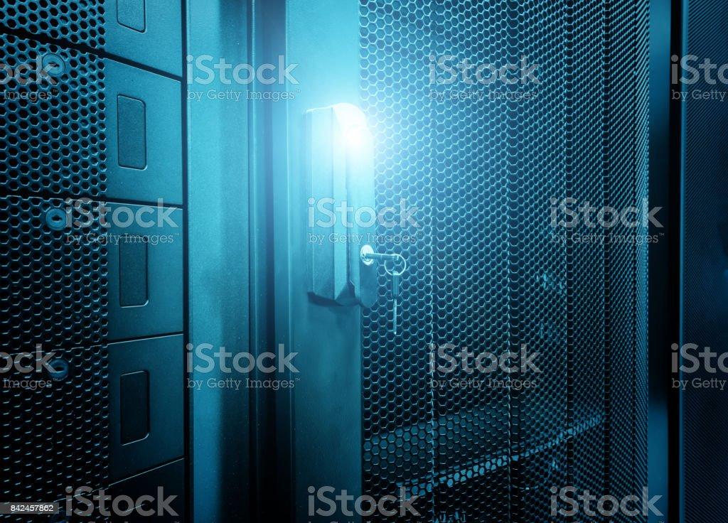 Door perforated of server rack cabinet. The key is inserted into door lock. stock photo